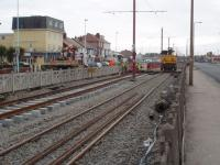 The Blackpool and Fleetwood tramway relaying is currently (Feb 09)concentrated on the reserved section between the two carriageways in Cleveleys. This view is south towards Blackpool and shows the contractor's rail mounted crane with new track in evidence. <br><br>[Mark Bartlett 17/02/2009]