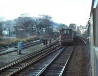 <I>Oops - and not an orange jacket in sight</I>. Brush Class 47, 47463, heading for Holyhead with a passenger train, creeps gingerly past a derailed brake van and coal trucks at Colwyn Bay. My records show the loco in charge of the freight was a Class 40, 40031, the former <I>Sylvania</I>, which was withdrawn two months later. The Class 47 lasted a further 14 years and both were dismantled in Crewe Works.<br><br>[Mark Bartlett 15/03/1981]