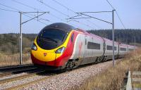 Glasgow bound Pendolino at Fullwood, between Carluke and Lanark Junction, on 20 March 2009<br><br>[Bill Roberton 20/03/2009]