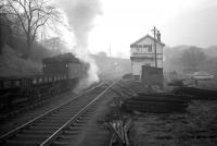 Q6 63379 clatters past Beamish signal box on a misty morning in February 1964 with a train of flats heading for Consett steelworks.<br><br>[Robin Barbour Collection (Courtesy Bruce McCartney) 15/02/1964]