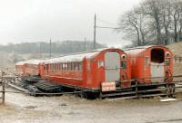 Withdrawn Glasgow Subway stock at Beamish in 1979. The six redundant units had been obtained 2 years previously and were intended for use by the museum in the construction of replica tramcars. What eventually happened to the idea,... or the cars themselves, is not known.<br><br>[Colin Miller //1979]