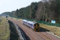 With redoubling and bridge alterations complete, a Bathgate - Waverley service approaches the site of Bangour Jct on 18 March 2009. Electrification is due to arrive soon, marking an end to regular diesel traffic on the line.<br><br>[James Young 18/03/2009]