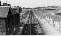 Some twenty years after its closure in 1939 this is a view of Barton and Broughton station looking north along the West Coast Main Line. The wooden buildings on the Up platform look in good condition but were later demolished and the platform removed. However, the more substantial stone buildings on the down side remained in use as private residences into the 21st century but were demolished in 2013. [See image 18206]. Picture believed to have been taken by G H Platt. <br><br>[Rev Ron Greenall Collection //1959]