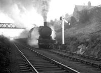 A hard working Q6 no 63379 climbs through Beamish past a notable North Eastern signal post hauling empty steel flats destined for Consett on 15 February 1964.<br><br>[K A Gray 15/02/1964]