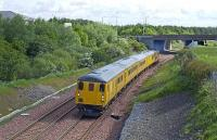 <i>DBSO 9701</i>, with a Class 31 locomotive propelling, passes the site of Bangour Junction on 26 May 2009 with a test train to Bathgate. <br><br>[James Young 26/05/2009]