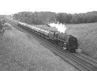 A 9F 2-10-0 with a northbound cement train near Braidwood on Glasgow Fair Saturday in July 1966.<br><br>[Colin Miller /07/1966]