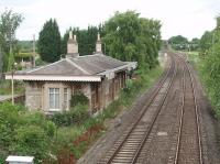 Aynho station, closed in 1964, still stands alongside the Oxford to Banbury line. This is the view north from the overbridge and, in the distance, the flyover at Aynho Junction can be seen where the down Princes Risborough direct line is carried over the bridge to join the line in the foreground. <br><br>[Mark Bartlett 18/06/2009]