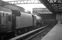 Black 5 no 45084 of Stirling South shed stands at the buffer stops at Glasgow Buchanan Street on 23 August 1965.<br><br>[K A Gray 23/08/1965]