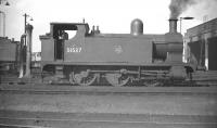 Aspinall ex-L&Y 0-6-0T no 51537 stands on Aintree shed in September 1958. One of several <I>dock tanks</I> based here, these locomotive would have spent most of their lives shunting Liverpool Docks. [Editor's note: What is often referred to as a spark-arresting device is, according to Paul Ford, a 'blast deflector' fitted to locomotives shunting the dock estate to protect the deck of the Liverpool Overhead Railway]. <br><br>[Robin Barbour Collection (Courtesy Bruce McCartney) 26/09/1958]