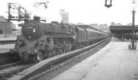One of the St Rollox batch of Caprotti valve-geared BR Standard class 5s, no 73149, prepares to take a Dundee train away from Glasgow's Buchanan Street terminus in July 1966.<br><br>[K A Gray 25/07/1966]