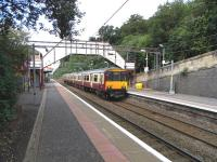 Looking across the tracks towards the northbound platform at Bearsden on 8 August as 318 259 arrives on a service for Milngavie.<br><br>[David Panton 08/08/2009]