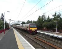 A six car 320 formation arrives at Clydebank on 8 August 2009, destination Springburn. The named sets are <I>High Road 20th Anniversary 2000</I> followed by <I>Royal College of Physicians and Surgeons of Glasgow</I>.<br> <br><br>[David Panton 08/08/2009]