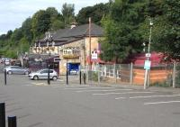 The former station building at Bearsden (opened 1863) - now houses a stylish pub/restaurant known as <i>The Inn</i>. Photographed on 8 August 2009, with its modern day replacement standing alongside on the right and the platform entrance between the two.<br><br>[David Panton 08/08/2009]