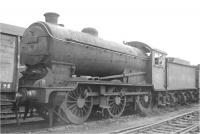 Ex-LNER J39 0-6-0 no 64733 awaiting scrapping at Cowlairs in July 1962, having been withdrawn from Carlisle Canal shed 9 months earlier and arrived here via Eastfield [see image 45637].<br><br>[Ken Browne 08/07/1962]