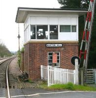 The signal box and level crossing at Barton Hill, North Yorkshire, on the York - Scarborough line, looking east towards Malton in April 2009. The former station here stood on the other side of the crossing and was closed to passengers in 1930.<br><br>[John Furnevel 19/04/2009]