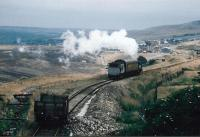 The Blaenavon Express: the P&B used to have only one operating steam engine, with BROOKFIELD emblazoned on its tanks IIRC. It is pushing its single coach up to the later location of Whistle Inn halt in September 1991. The 'landscaped' background looks distinctly bleak; as viewers of the TV programme 'Time Team' will know, it contains a buried viaduct.<br><br>[Ken Strachan /09/1991]
