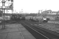 The 17.15 Aberdeen - Glasgow train arrives at Buchanan Street station in August 1966 behind NBL Type 2 locomotive no D6106.<br><br>[Colin Miller /08/1966]