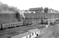 The approach to Bradford Exchange in the 1960s showing an LMS 2-6-4T heading up the bank, a Class 24 approaching with what is probably empty coaching stock, and a Class 40, possibly waiting to become the train engine for that stock. At this time Bradford Exchange enjoyed through trains to London and these continued even after the station was cut back prior to becoming the much simplified Bradford Interchange  [see image 25061] The platforms for the 'new' Interchange station now extend almost to the point where the original signal gantry stood.<br><br>[Robin Barbour Collection (Courtesy Bruce McCartney) //]