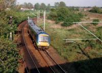 This picture is only 8 years old, but already historic, as Turbostars now rarely travel this way; but rather over reinstated track over the bridge just visible in the right background. see image [[34978]] The 170 is heading for Birmingham, but the destination blind said: 'Norwich. Sorry?' The North Chord was barely a twinkle in NR's eye at this point!<br><br>[Ken Strachan //2001]