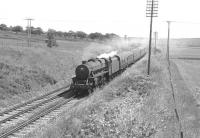 A Glasgow Fair Saturday southbound extra headed by Black 5 no 45455 off 12A Kingmoor shed, photographed near Braidwood on the WCML in July 1966.<br> <br><br>[Colin Miller /07/1966]