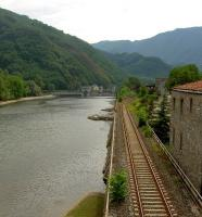 View south from the Ponte della Maddalena at Borgo a Mozzano, Tuscany, showing the Lucca - Aulla line running along the west bank of the River Serchio.<br><br>[Iain Steel 07/08/2007]