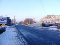 Looking along Dalmarnock Road on a cold December afternoon. The mound on the right is all that remains of the arches that carried the Switchback line. <br><br>[Colin Harkins 28/12/2009]