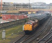 View north as EWS 37716 pulls away from Bradford Interchange in April 1998 with the Laisterdyke - Liverpool Docks scrap metal working, having just run round its train. Note the ongoing development work in the background, including (just off picture to the right) land formerly occupied by Bradford Exchange station. For a 1960s view in the opposite direction, featuring the wall on the left [see image 26905].<br><br>[David Pesterfield 01/04/1998]