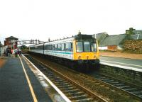 In their last months of service 117s were used to form specials from <br> Edinburgh for the Open Golf at Carnoustie in 1999.� Here on 17 <br> July an ECS set returns to the main line from the siding where it <br> allowed a train to pass.� It then changed ends, moved to the up line and returned in the direction of Dundee.<br> <br><br>[David Panton 17/07/1999]