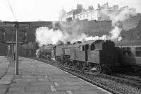Scene at Birkenhead Woodside station with Fairburn 2-6-4T no 42086 standing in the foreground as a Black 5 takes a train out of the terminus towards Woodside Tunnel. The photograph is thought to have been taken on 3 March 1967.<br> <br><br>[Robin Barbour Collection (Courtesy Bruce McCartney) 03/03/1967]