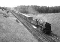 A northbound mixed freight runs through Braidwood behind a BR class 9F 2-10-0 in July 1966.<br><br>[Colin Miller 15/07/1966]