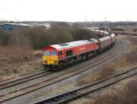 DBS 59206 hauls a trainload of coal out of Warrington yard towards Arpley Junction on 3 March 2010. Once through the junction the locomotive will run round its train for the second time before setting off west towards Fiddlers Ferry power station.<br> <br><br>[John McIntyre 03/03/2010]