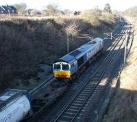 DRS 66414 heads north near Bay Horse on the WCML with an Intermodal service on 4 March 2010.<br> <br><br>[John McIntyre 04/03/2010]