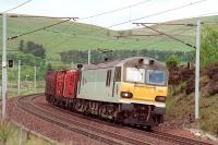 92014 south of Abington with a Mossend - Chirk log train in May 2000.<br> <br><br>[Bill Roberton /05/2000]