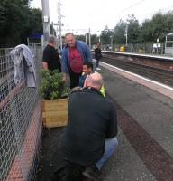 Volunteers at work on one of the platform displays at Carntyne on 7 October 2013. <br><br>[John Yellowlees 07/10/2013]