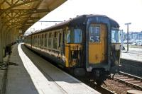In their original form, the Class 309 'Clacton' EMUs had attractive wraparound windscreens, but they offered drivers little protection against impacts from bricks and other missiles that vandals were apt to hurl at trains in the 1970s. The windows were remodeled, detracting from the overall appearance, in the late 1970s. Shown here is an unrebuilt example waiting to leave Clacton on 3rd July 1977. [See image 40041]<br><br>[Mark Dufton 03/07/1977]