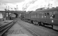 One of the St Rollox batch of BR Caprotti class 5s no 73149 takes a Dundee train out of Buchanan Street in 1964<br><br>[K A Gray //1964]