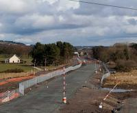 Looking east from the A801 in April 2010 as a new bridge takes shape connecting the Falside and Standhill areas. This area once formed junctions for mines at West Mains, Torbanehill and Whiteside.<br><br>[James Young 04/04/2010]