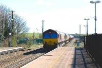 A pair of class 66 locomotives, led by 66138, with westbound oil tanks through Cholsey in April 2010. The tanks are destined for the Westerleigh oil depot near Yate.<br><br>[Peter Todd 08/04/2010]