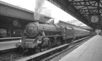 Black 5 no 44794 bides its time with the 5.50pm Dunblane service waiting to leave Glasgow's Buchanan Street station in July 1966.<br><br>[K A Gray 26/07/1966]