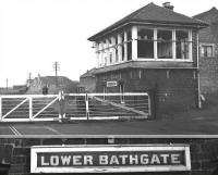 The level crossing and signal box at Lower Bathgate, complete with close-up of nameboard, photographed in February 1970, a short time after closure. <br><br>[Bill Jamieson /02/1970]