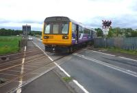 A Northern rail Newcastle to Carlisle service crosses the B6321 just west of Corbridge on 30 May 2010. <br><br>[John Steven 30/05/2010]