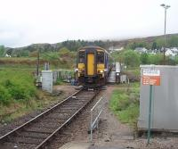The 0603 from Mallaig crosses the Caledonian Canal swing bridge at the regulation 5mph and rolls in to Banavie station on time at 0718. 156456 will reverse at Fort William and go forward to Glasgow Queen Street where it is scheduled to arrive at 1130am. <br><br>[Mark Bartlett 19/05/2010]