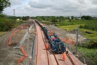 Tracklaying underway between Bathgate and Armadale on 9 June 2010.<br><br>[James Young 09/06/2010]