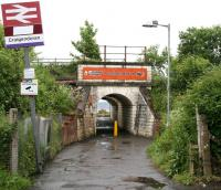 Entrance to Craigendoran station from Dennistoun Crescent on the north side of the line in June 2010. The tunnel passes below the West Highland tracks and opens out onto the station's remaining operational platform. The Clyde can be seen beyond. <br><br>[John Furnevel 08/06/2010]