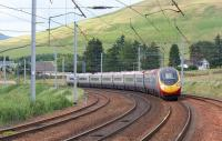 The 1740 hrs Glasgow Central to London Euston Pendolino service leans into the curve as it passes the Abington loops on 3 July 2010. <br> <br><br>[John McIntyre 03/07/2010]