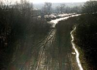 The closed and overgrown Spen Valley line at Cleckheaton looking south on 14 February 1997. The track has been truncated to make way for a car park extension to the Tesco supermarket in the left background.<br><br>[David Pesterfield 14/02/1997]