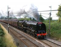 Ex-LMS <I>Coronation</I> Pacific no 6233 <i>Duchess of Sutherland</i> heads north on the WCML on 24 July 2010 with the <I>Cumbrian Mountain Express</I> from Liverpool to Carlisle. The train has just restarted from Barton Down Loop, having been held to allow passage of a northbound Pendolino.<br><br>[John McIntyre 24/07/2010]