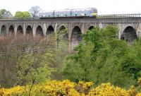 A Glasgow - Edinburgh shuttle approaching Linlithgow on the Avon viaduct  in 2005.<br><br>[John Furnevel 30/05/2005]