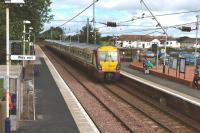 On 27th July 2010 the 10.30 Glasgow Central - Ayr train runs into Barassie station for its 11.10 scheduled stop. [See image 21465 for the same viewpoint forty seven years earlier]<br><br>[Colin Miller 27/07/2010]