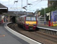 320 315 stands at the eastbound platform at Coatbridge Sunnyside with an Airdrie service.  In a few short months lucky Coatbridgers will be able to catch a regular service from that platform to Edinburgh (should that be their wish).<br><br>[David Panton 14/08/2010]